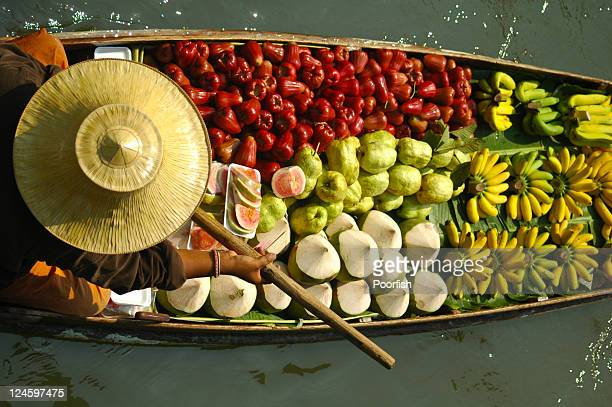 fruit boats - floating market stock photos and pictures
