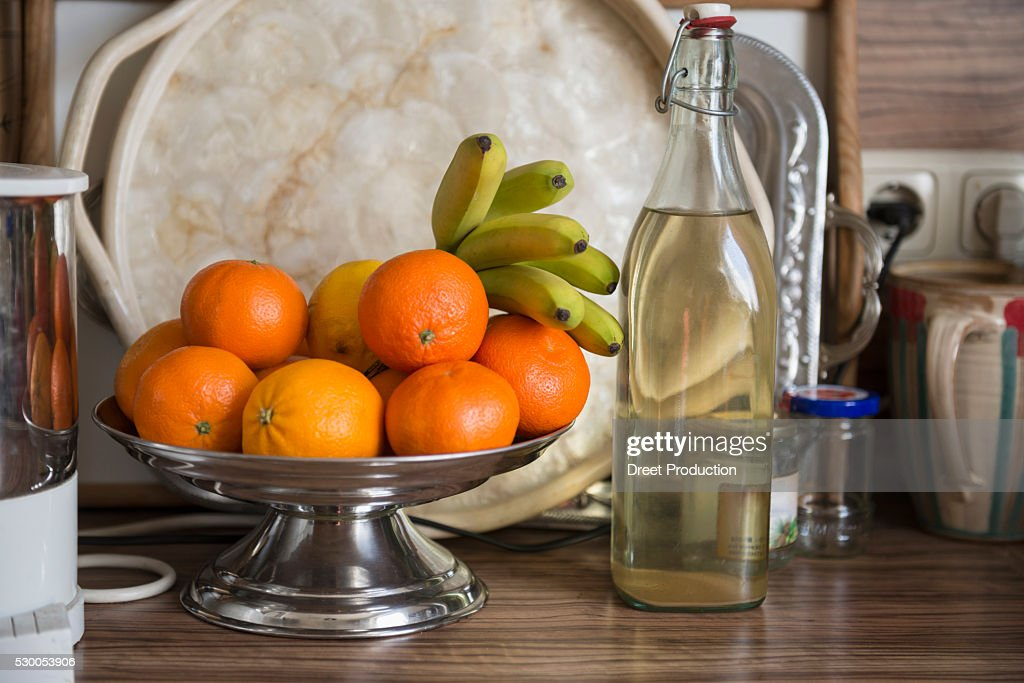 Fruit bowl with elderberry syrup on kitchen counter, Munich, Bavaria, Germany : Stock Photo
