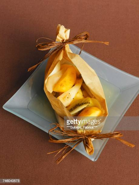 Fruit cooked in wax paper
