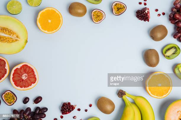 fruit flat lay from above colorful food background - fruit stock pictures, royalty-free photos & images