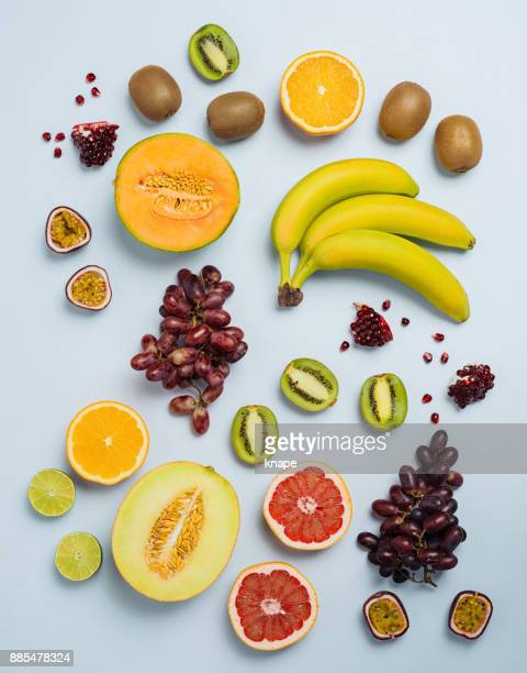 Fruit flat lay from above colorful food background