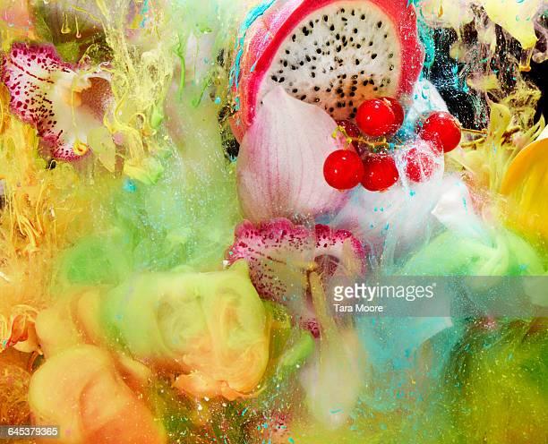 fruit, flowers and paint in water - comida flores fotografías e imágenes de stock