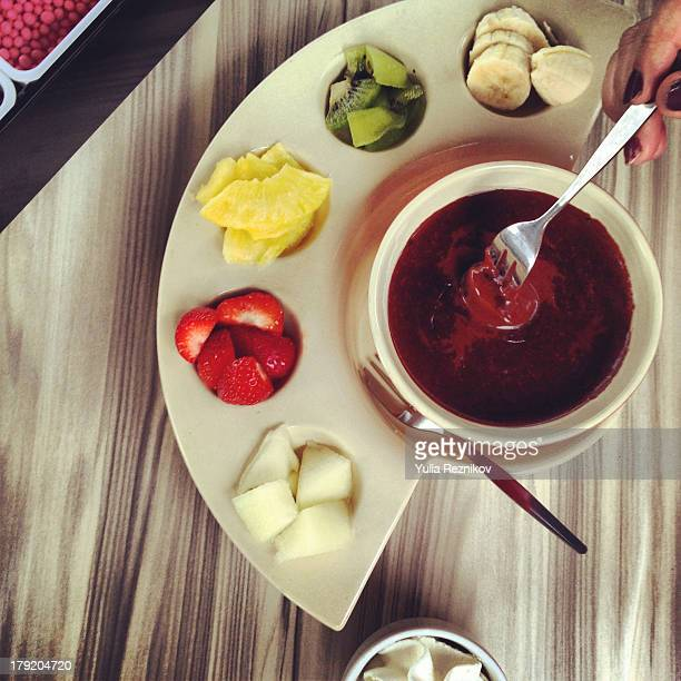 fruit fondue with chocolate,strawberry and melon