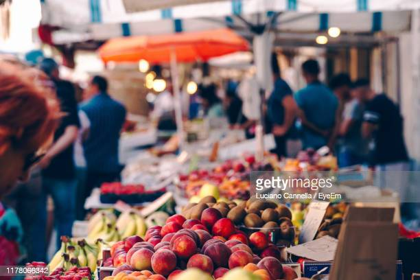 fruit for sale at market stall - street market stock pictures, royalty-free photos & images