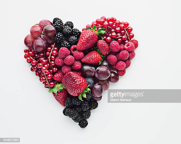 fruit forming heart-shape - fruit stock pictures, royalty-free photos & images