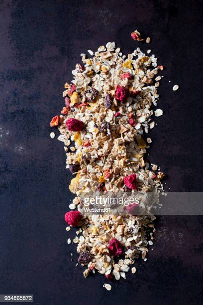 fruit granola with dried raspberries, strawberries and cranberries - granola stock pictures, royalty-free photos & images