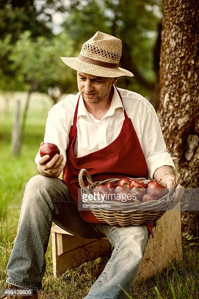 fruit grower in his orchard tasting apple harvest
