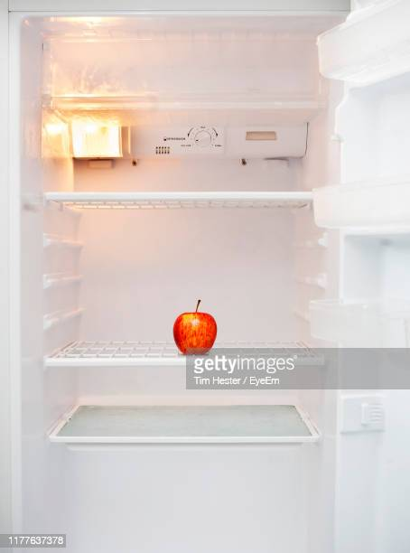 fruit in refrigerator at home - empty fridge stock pictures, royalty-free photos & images