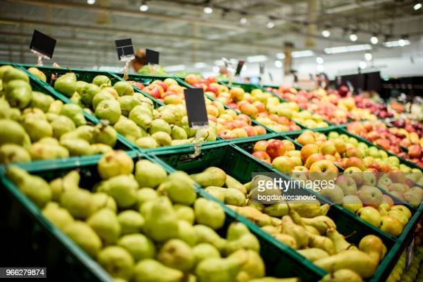 fruit in supermarket - produce aisle stock photos and pictures
