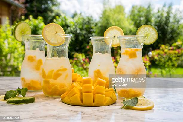 Fruit infused water with mango, lime and lemon