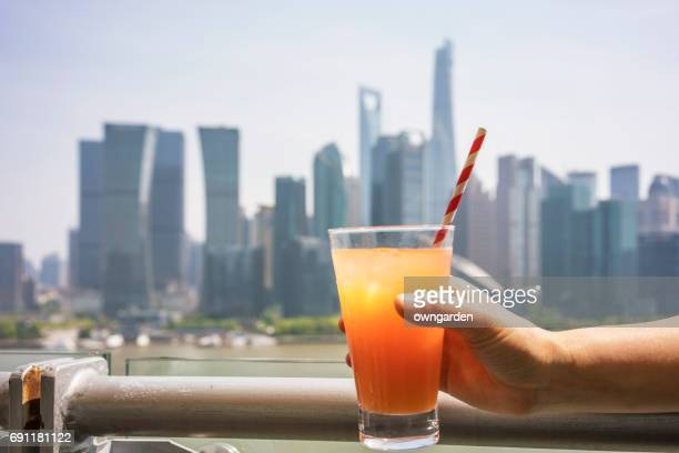 Fruit juice and shanghai skyline