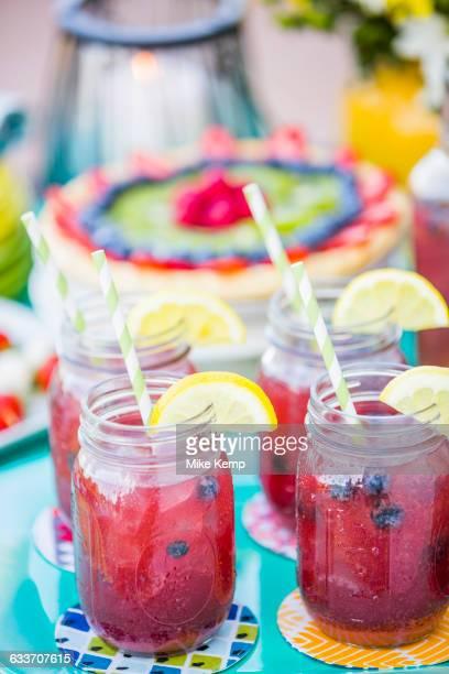 Fruit juice in jars outdoors