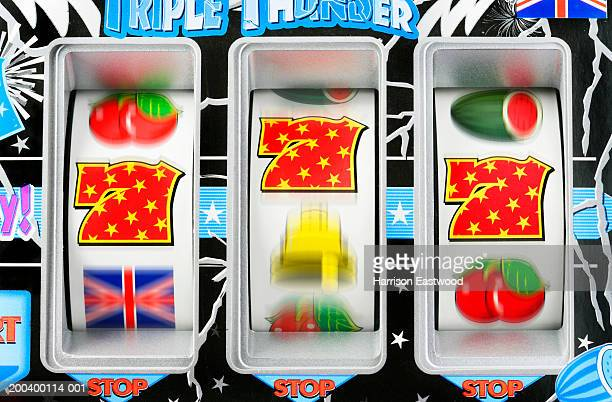 fruit machine bars spinning to line of 7's, close-up (blurred motion) - gambling stock pictures, royalty-free photos & images