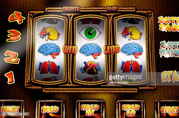 Fruit machine with health and physical themed reels, close up