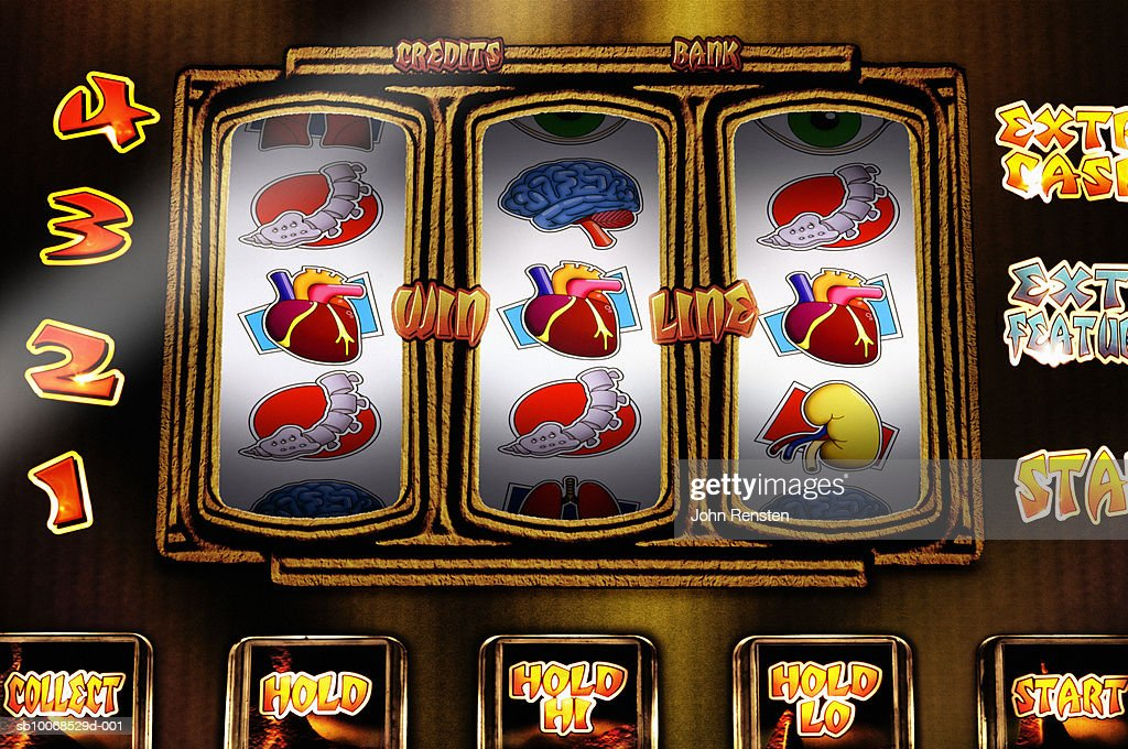 Fruit machine with health and physical themed reels, close up : Stock Photo