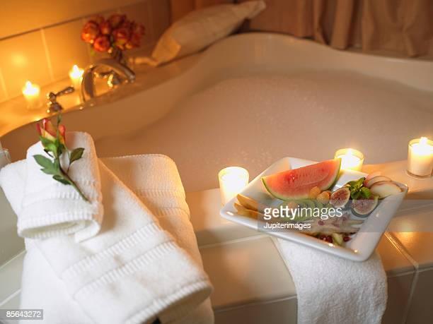 Fruit plate next to bathtub