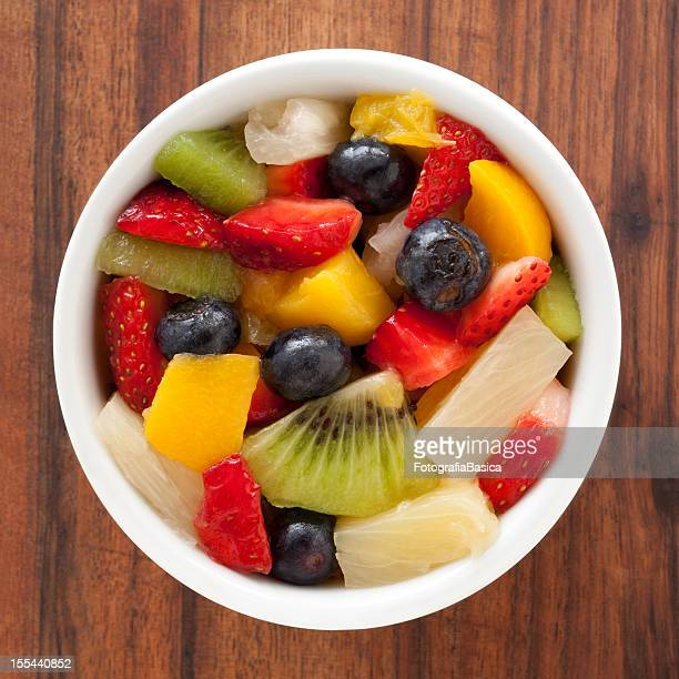 fruit salad - pared stock pictures, royalty-free photos & images