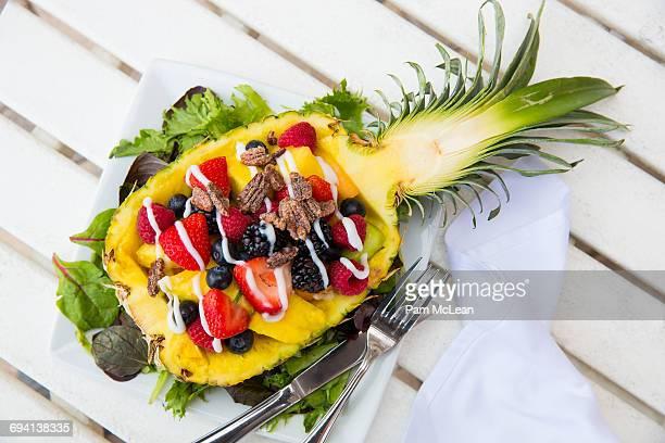 Fruit salad served in a half pineapple