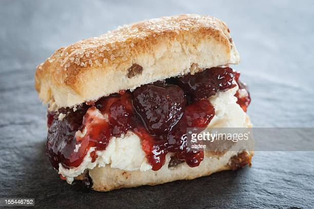 Fruit scone with strawberry jam and cream