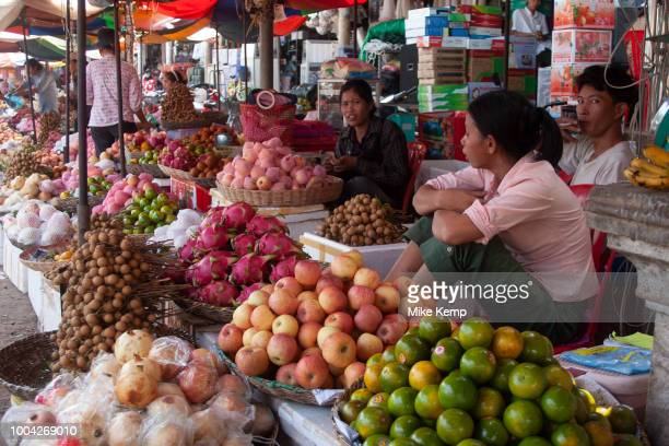 Fruit seller at Psar Leu market at the heart of this transport stop just outside Siem Reap to the east Angkor Cambodia This huge market entirely...