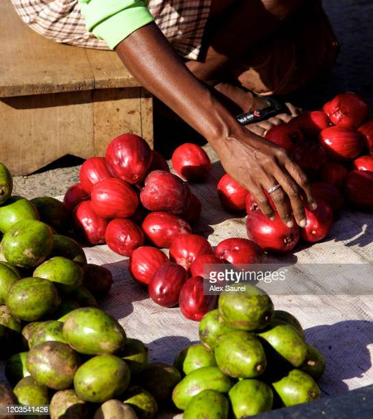 """fruit seller in """"pasar reimu"""" market in soring, papua - papua province indonesia stock pictures, royalty-free photos & images"""