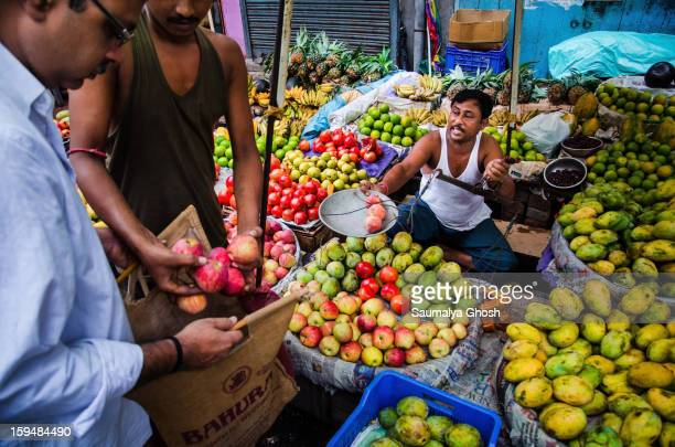CONTENT] A fruit seller is busy with his business on the streets of Kolkata