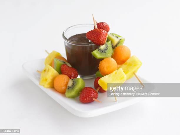 Fruit skewers with chocolate orange dip on plate