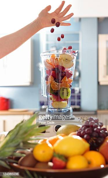fruit smoothies - newpremiumuk stock pictures, royalty-free photos & images