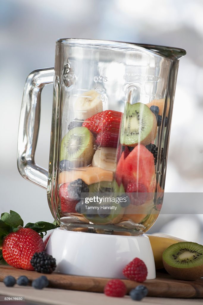 Fruit smoothy contents in a blender : Foto de stock