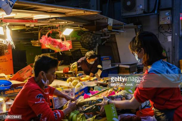 A fruit stall owner selling fruits during a coronavirus outbreak on March 26 2020 in Hong Kong China Latest statistics showed Hong Kong tourist...