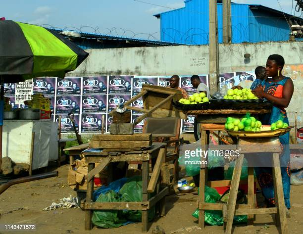 fruit stall - street seller on akowonjo road, lagos, nigeria - nigerian food stock pictures, royalty-free photos & images