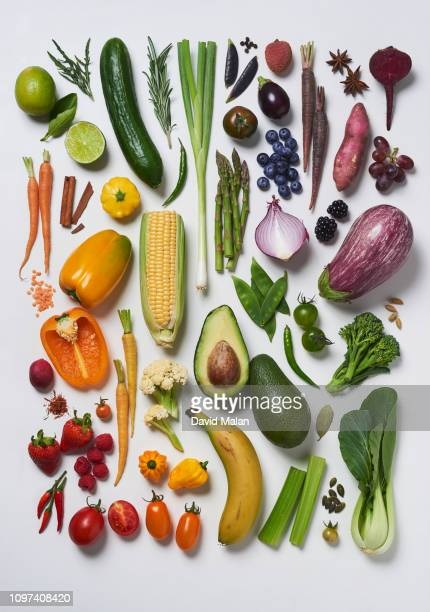 fruit, vegetables, herbs and spices arranged by colour. - root vegetable stock pictures, royalty-free photos & images