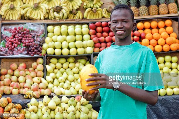 A fruit vendor at his stall
