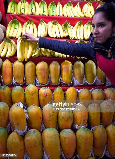 A fruit vendor displays bananas for sale at the 'Central de Abasto' wholesale market in Mexico City on January 30 2018 Until the first half of...