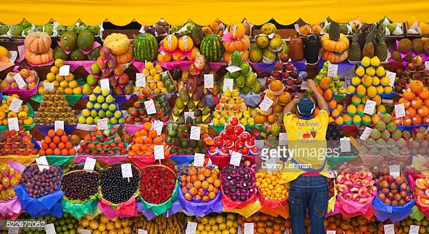 fruit vendor in the municipal market, sao paulo, brazil - bancarella di verdura foto e immagini stock