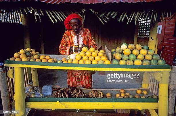 fruit vendor. - port of spain stock pictures, royalty-free photos & images