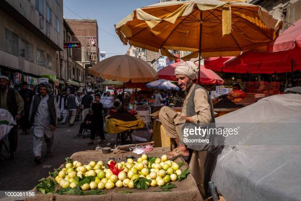 A fruit vendor waits for customers at Mandai Bazaar in Central Kabul Afghanistan on Thursday July 12 2018 US President Donald last year said 16000 US...