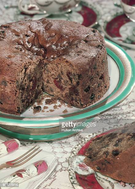 A fruitcake on a plate circa 1955