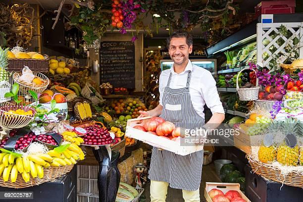 fruiterer carrying tray of fruits in shop, palma de mallorca, spain - palma maiorca - fotografias e filmes do acervo