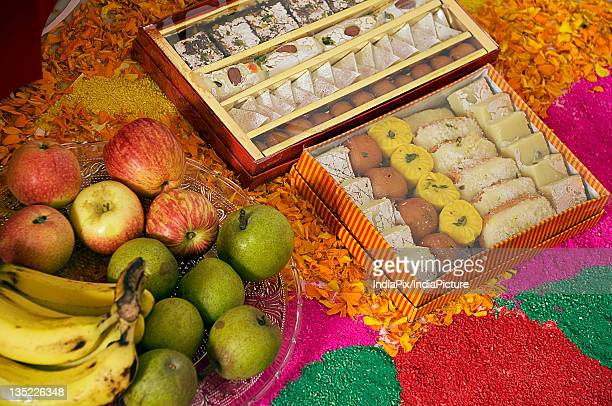 fruits and sweets - diwali sweets stock photos and pictures