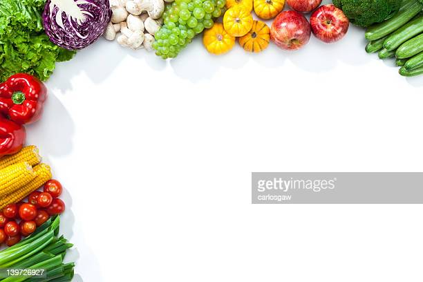 Fruits and vegetables disposed on a half frame shape