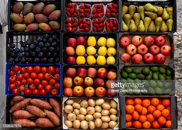 fruits and vegetables for sale at market stall - フルーツ ストックフォトと画像