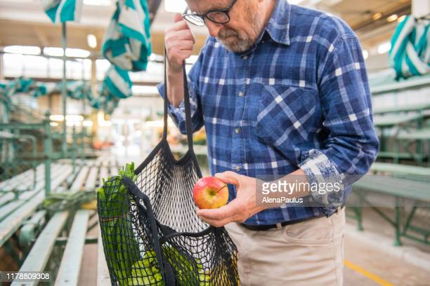 fruits and vegetables in a black cotton mesh reusable bag, zero waste shopping on outdoors market - inserting stock pictures, royalty-free photos & images