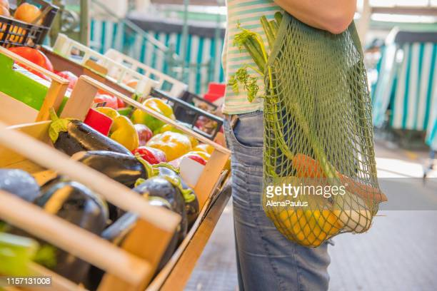 fruits and vegetables in a cotton mesh reusable bag, zero waste shopping concept - food and drink stock pictures, royalty-free photos & images