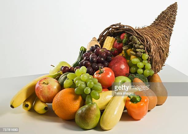 fruits and vegetables in cornucopia basket - 豊穣の角 ストックフォトと画像