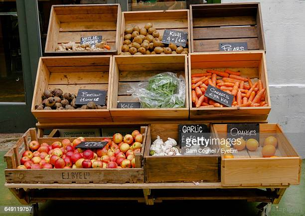 Fruits And Vegetables In Crates At Market Stall