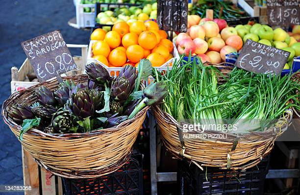 Fruits and vegetables on sale are displayed in a street market in central Rome on November 30 2011 AFP PHOTO / ALBERTO PIZZOLI