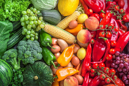 Fruits and vegetables overhead assortment on colorful background 615522818