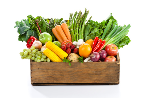 Fruits and veggies in wood box with white backdrop 160356158