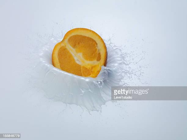 Fruits drop on milk